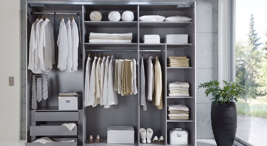 organised wardrobe with clothing dividers
